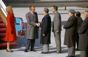 Nixon shakes hands with Chou En-lai